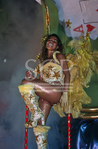 Rio de Janeiro, Brazil. Samba dancers during the carnival parade; silver and gold, feathers, sparkle, glitter.
