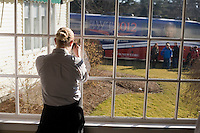 A Nashua Country Club waitress takes a picture of the Gingrich campaign bus after Newt Gingrich spoke to the Nashua Rotary Club at the Nashua Country Club in Nashua, New Hampshire, on Jan. 9, 2012.  Gingrich is seeking the 2012 Republican presidential nomination.