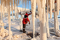 A LUKoil worker repairs a leaking pipe carrying natural gas in the Russian Arctic. /Felix Features