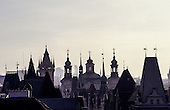 Prague, Czech Republic; panoramic overview of the old city with spires and turrets (person in one turret).
