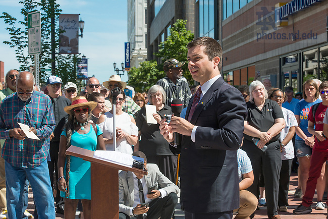June 21, 2017; Mayor Pete Buttigieg walks with community leaders before the unveiling of the new sculpture of the Rev. Theodore M. Hesburgh and the Rev. Martin Luther King in downtown South Bend.  (Photo by Barbara Johnston/University of Notre Dame)