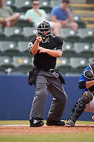 Umpire David Arrieta makes a call during a game between the Birmingham Barons and Biloxi Shuckers on May 24, 2015 at Joe Davis Stadium in Huntsville, Alabama.  Birmingham defeated Biloxi 6-4 as the Shuckers are playing all games on the road, or neutral sites like their former home in Huntsville, until the teams new stadium is completed in early June.  (Mike Janes/Four Seam Images)
