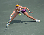 Eugenie Bouchard (CAN) defeats Jelena Jankovic (SRB) 6-3, 4-6, 6-3 at the Family Circle Cup in Charleston, South Carolina on April 4, 2014.