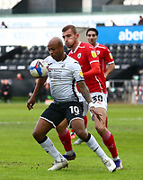 19th December 2020; Liberty Stadium, Swansea, Glamorgan, Wales; English Football League Championship Football, Swansea City versus Barnsley; Andre Ayew of Swansea City controls the ball whilst pressured by Michal Helik of Barnsley