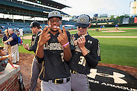 Garrett Gooden (2) of St. Pius X Catholic High School in Decatur, Georgia jokes for the camera as Mitchell Miller (30) of Loganville High School in Covington, Georgia signs autographs for fans after the Under Armour All-American Game on August 15, 2015 at Wrigley Field in Chicago, Illinois. (Mike Janes/Four Seam Images)