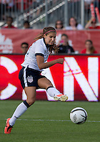 02 June 2013: U.S. National Team Player Alex Morgan #13 scores the second of two goals during an international friendly soccer match between the U.S Women's National Team and the Canadian Women's National Team at BMO Field in Toronto, Ontario Canada.<br /> The U.S. National Women's Team won 3-0.