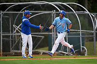 Indiana State Sycamores coach Brian Smiley congratulates Brandt Nowaskie (16) after hitting a home run during a game against the Dartmouth Big Green on February 21, 2020 at North Charlotte Regional Park in Port Charlotte, Florida.  Indiana State defeated Dartmouth 1-0.  (Mike Janes/Four Seam Images)