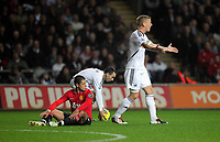 Pictured: Garry Monk of Swansea (R) protesting to the match referee for his decision to award a foul against Patrice Evra of Manchester United (L). Saturday 19 November 2011<br /> Re: Premier League football Swansea City FC v Manchester United at the Liberty Stadium, south Wales.