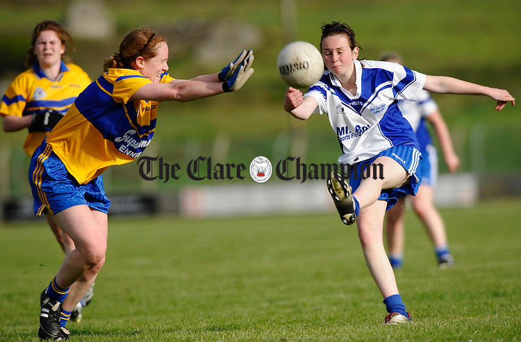 Louise Henchy of The Banner moves to Block West Clare Gaels Niamh Lardner  during the Ladies Football Division 1 final at Quilty. Photograph by John Kelly.