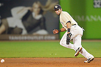 Wake Forest Demon Deacons first baseman Carlos Lopez #3 tracks a ground ball during the game against the Miami Hurricanes at NewBridge Bank Park on May 25, 2012 in Winston-Salem, North Carolina.  The Hurricanes defeated the Demon Deacons 6-3.  (Brian Westerholt/Four Seam Images)