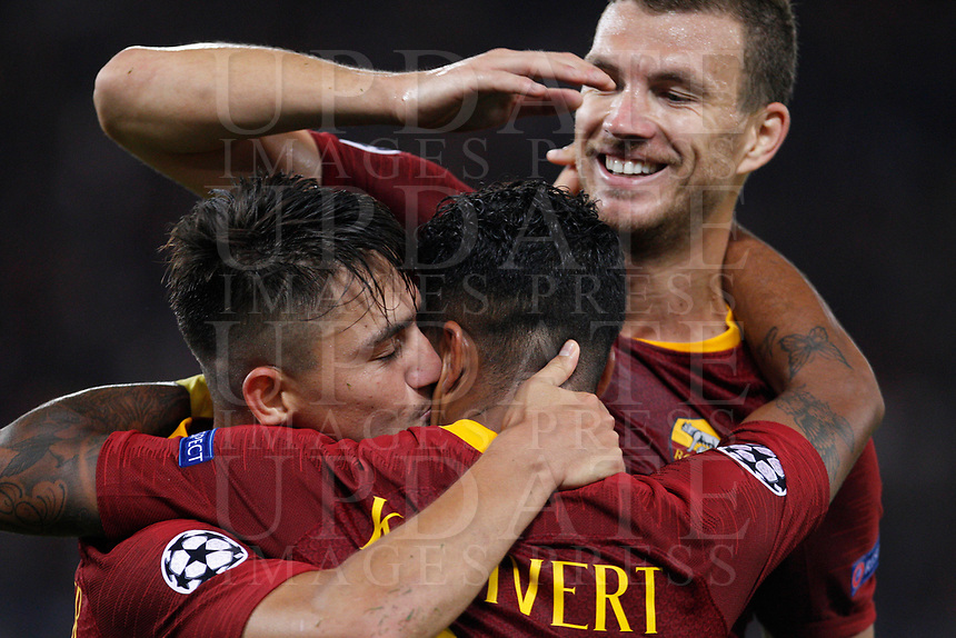 Roma's Justin Kluivert, center, celebrates with his teammates Cengiz Under, left, and Edin Dzeko, after scoring during the Champions League football match between Roma and Viktoria Plzen at Rome's Olympic stadium, October 2, 2018.<br /> UPDATE IMAGES PRESS/Riccardo De Luca