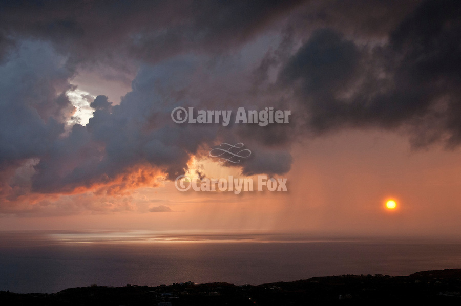 Morning storm at sunrise over the island of Anafi in the Aegean Sea from Fira, Santorini (Thira), Greece