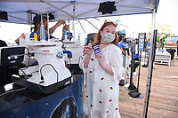 """SANTA MONICA, CA - AUGUST 13: Julia Lester attends the """"Disney+: The Stories Continue"""" tour on the Santa Monica Pier on August 13, 2021 in Santa Monica, California. (Photo by Stewart Cook/Disney+/PictureGroup)"""