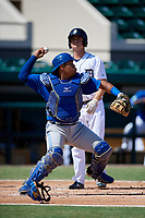 Toronto Blue Jays catcher Yorman Rodriguez (50) throws to third base during an Instructional League game against the Detroit Tigers on October 12, 2017 at Joker Marchant Stadium in Lakeland, Florida.  (Mike Janes/Four Seam Images)