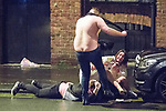 © Joel Goodman - 07973 332324 . 01/01/2017 . Manchester , UK . A shirtless man repeatedly kicks another man lying in the gutter as a fight involving several men and women spills over on to St Mary's Parsonage . People on a night out in Manchester City Centre , after midnight on January 1st 2017 . Photo credit : Joel Goodman