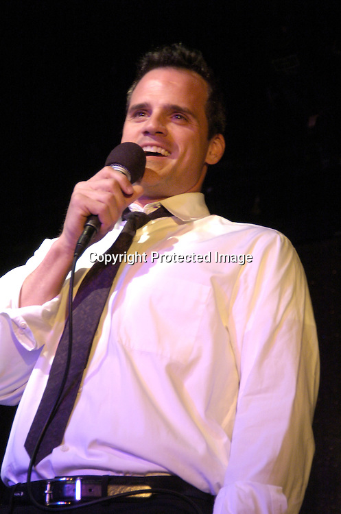 Michael Park singing..at The Goldin and Park Cabaret starring Ricky Paull Goldin from Guiding Light and Michael Park from As The World Turns. Kim Zimmer, Robert Newman and Mandy Bruno also sang. This was at The Triad NYC on April 16, 2005, and  was a benefit for Bill Runyon's family. ..Photo by Robin Platzer, Twin Images