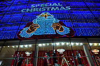 Switzerland. Canton Ticino. Lugano. Downtown. Manor. Shopping center. Special christmas decoration. Father Christmas illuminated at night. Traditional Santa Claus. Manor AG is a Swiss department store chain and is owned by Maus Frères of Geneva, and is Switzerland's largest department-store chain. 22.10.2018 © 2018 Didier Ruef
