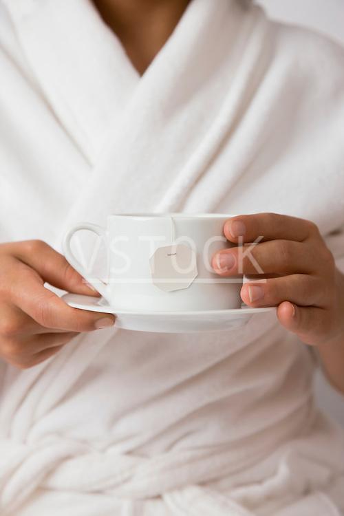 USA, Illinois, Metamora, Young woman holding tea cup