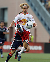 New York Red Bulls defender Stephen Keel (22) clears the ball. In a Major League Soccer (MLS) match, New England Revolution defeated New York Red Bulls, 2-0, at Gillette Stadium on July 8, 2012.