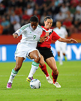 Rhian Wilkinson (r) of team Canada and Desire Oparanozie of team Nigeria during the FIFA Women's World Cup at the FIFA Stadium in Dresden, Germany on July 5th, 2011.
