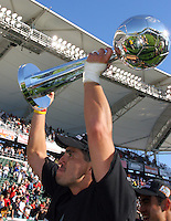D.C. United's Jaimie Moreno holds the MLS Cup  after defeating the Kansas City Wizards 3-2, at the Home Depot Center, in Carson, Calif., Sunday, Oct. 14, 2004. .MLS Cup, at the Home Depot Center, in Carson, Calif., Sunday, Oct. 14, 2004.