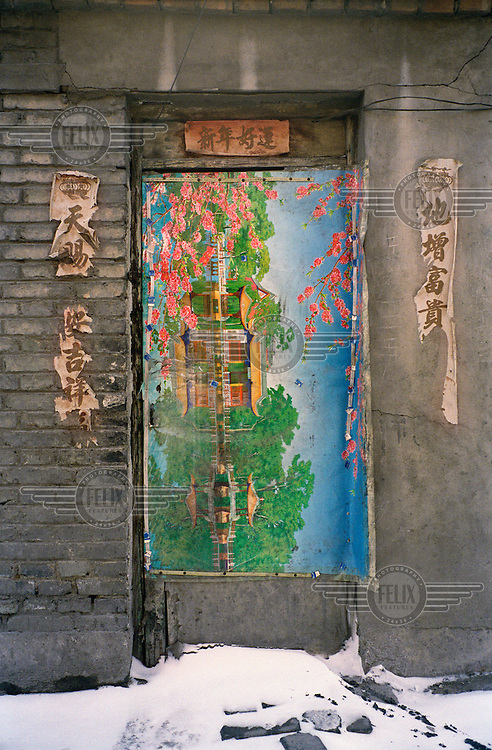 Painting affixed to a doorway in a residential area for miners.