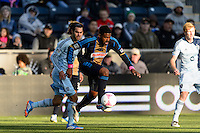 Sheanon Williams (25) of the Philadelphia Union plays the ball as Graham Zusi (8) of Sporting Kansas City watches. Sporting Kansas City defeated the Philadelphia Union 2-1 during a Major League Soccer (MLS) match at PPL Park in Chester, PA, on October 26, 2013.