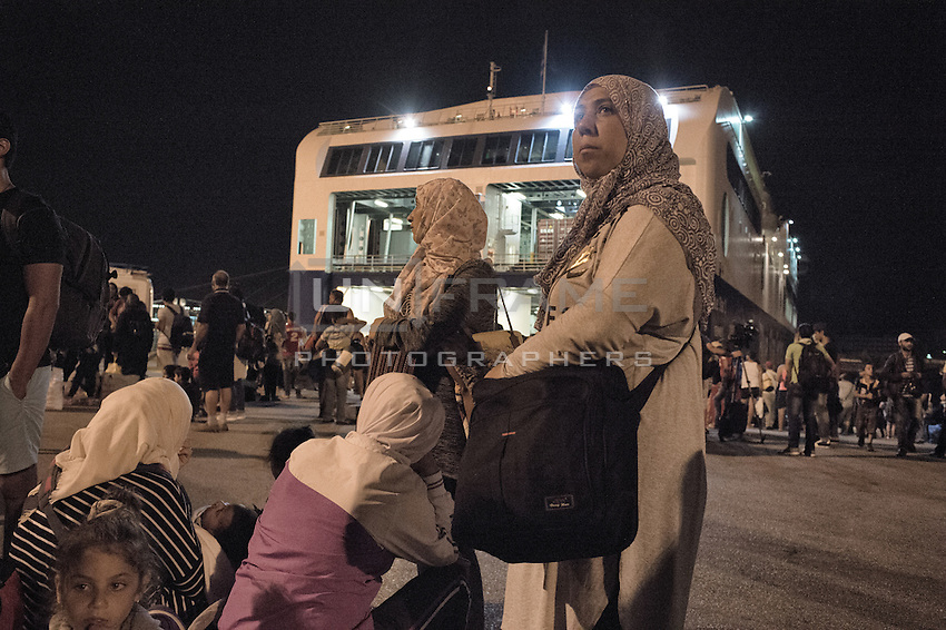 Migrants on a ferry land in Athens and prepare for their next journey to MAcedonia. Athens, Greece. Sept. 8, 2015