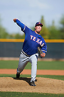 Texas Rangers pitcher Blake Bass (61) during an instructional league game against the Los Angeles Angels / Chicago Cubs co-op team on October 5, 2015 at the Surprise Stadium Training Complex in Surprise, Arizona.  (Mike Janes/Four Seam Images)