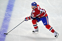22 April 2009: Montreal Canadiens' center and Team Captain Saku Koivu from Finland brings the puck across the blue line during the first period against the Boston Bruins at the Bell Centre in Montreal, Quebec, Canada. The Bruins advanced to the Eastern Semi-Finals, eliminating the Canadiens from Stanley Cup competition with a 4-1 win and series sweep. ***** Editorial Sales Only ***** Mandatory Credit: Ed Wolfstein Photo
