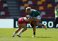 24th April 2021; Brentford Community Stadium, London, England; Gallagher Premiership Rugby, London Irish versus Harlequins; Cadan Murley of Harlequins tackles Ollie Hassell-Collins of London Irish