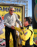 Nov 10, 2013; Pomona, CA, USA; NHRA pro stock driver Jeg Coughlin Jr (right) is congratulated by NHRA president Tom Compton after clinching the 2013 pro stock championship during the Auto Club Finals at Auto Club Raceway at Pomona. Mandatory Credit: Mark J. Rebilas-