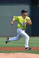 Shortstop Andres Gimenez (13) of the Columbia Fireflies throws out a runner at first in a game against the Rome Braves on Sunday, August 20, 2017, at Spirit Communications Park in Columbia, South Carolina. Rome won, 11-6 in 16 innings. (Tom Priddy/Four Seam Images)