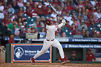Conor McKenna (5) of the Oklahoma Sooners follows through on his swing against the Arkansas Razorbacks in game two of the 2020 Shriners Hospitals for Children College Classic at Minute Maid Park on February 28, 2020 in Houston, Texas. The Sooners defeated the Razorbacks 6-3. (Brian Westerholt/Four Seam Images)