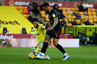 20th April 2021; Carrow Road, Norwich, Norfolk, England, English Football League Championship Football, Norwich versus Watford; Grant Hanley of Norwich City tackles Andre Gray of Watford as he was through on goal