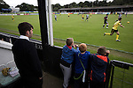 Elgin City 3 Edinburgh City 0, 13/08/2016. Borough Briggs, Scottish League Two. Young spectators in front of the main stand watching the action at Borough Briggs, home to Elgin City, on the day they played SPFL2 newcomers Edinburgh City (in yellow). Elgin City were a former Highland League club who were elected to the Scottish League in 2000, whereas Edinburgh City became the first club to gain promotion to the League by winning the Lowland League title and subsequent play-off matches in 2015-16. This match, Edinburgh City's first away Scottish League match since 1949, ended in a 3-0 defeat, watched by a crowd of 610. Photo by Colin McPherson.