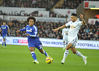 SWANSEA, WALES - JANUARY 17:   of  during the Barclays Premier League match between Swansea City and Chelsea at Liberty Stadium on January 17, 2015 in Swansea, Wales. <br /> Swansea's Neil Taylor on theball under pressure from Willian