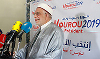 Ennahdha's Tunisian presidential candidate Abdelfattah Mourou (R) waves to supporters as he campaigns in Ettadhamen city on September 9, 2019 in the capital Tunis, ahead of the September 15 presidential election. - Chastened by its early experiences of holding power in post-revolution Tunisia, Islamist-inspired party Ennahdha has moderated its image and selected lawyer Abdelfattah Mourou as its candidate for next Sunday's presidential election