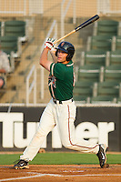 Chad Cregar #10 of the Greensboro Grasshoppers follows through on his swing against the Kannapolis Intimidators at Fieldcrest Cannon Stadium August 2, 2010, in Kannapolis, North Carolina.  Photo by Brian Westerholt / Four Seam Images