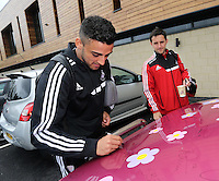 Pictured L-R: Neil Taylor and Richie Buchanan with the Suzuki Samurai at the Landore Training Ground. Saturday 10 May 2014<br />