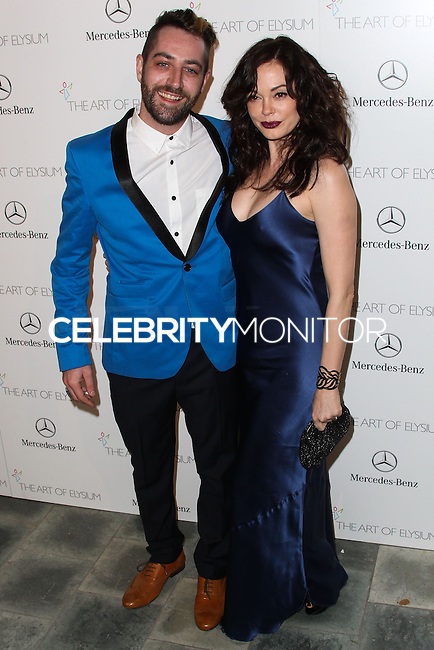 LOS ANGELES, CA - JANUARY 11: Davey Detail, Rose McGowan at The Art of Elysium's 7th Annual Heaven Gala held at Skirball Cultural Center on January 11, 2014 in Los Angeles, California. (Photo by Xavier Collin/Celebrity Monitor)