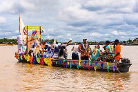 Afro-Colombian musicians travel the Atrato river in a colorfully adorned boat during the San Pacho festival in Quibdó, Colombia, 3 October 2019. Every year at the turn of September and October, the capital of the Pacific region of Chocó holds the celebrations in honor of Saint Francis of Assisi (locally named as San Pacho), recognized as Intangible Cultural Heritage by UNESCO. Each day carnival groups, wearing bright colorful costumes and representing each neighborhood, dance throughout the city, supported by brass bands playing live music. The festival culminates in a traditional boat ride on the Atrato River, followed by massive religious processions, which accent the pillars of Afro-Colombian's identity – the Catholic devotion grown from African roots.