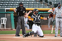 John Hester (22) of the Salt Lake Bees behind the plate with home plate umpire Adam Schwarz as the Reno Aces faced the Salt Lake Bees at Smith's Ballpark on July 23, 2014 in Salt Lake City, Utah.  (Stephen Smith/Four Seam Images)
