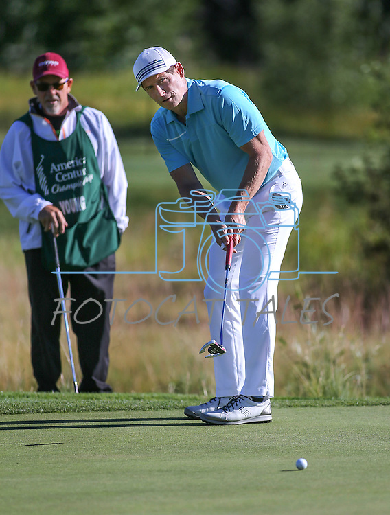 Former NFL player Steve Young putts in the final round of the American Century Championship at Edgewood Tahoe Golf Course in Stateline, Nev., on Sunday, July 19, 2015. <br /> Photo by Cathleen Allison