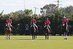 WELLINGTON, FL - NOVEMBER 25:  Team USA (Mike Azzaro, Julio Arellano, Carlitos Gracida, Grant Ganzi) passes by the stands, at the USPA International Cup at the Grand Champions Polo Club, on November 25, 2017 in Wellington, Florida. (Photo by Liz Lamont/Eclipse Sportswire/Getty Images)