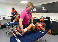 Swansea City's Leon Britton (right) in the treatment room on his first day back for the new season.