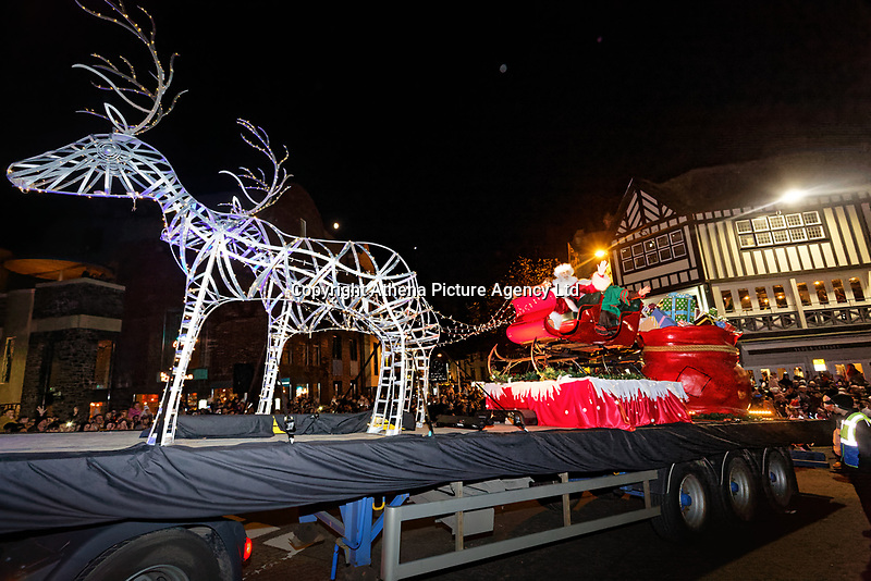 """Pictured: Father Christmas on one of the floats at the Christmas parade in Swansea, Wales, UK. Sunday 19 November 2018<br />Re: Swansea Christmas parade attended by thousands has been branded a """"shambles"""" for having just three floats.<br />The annual festive event in south Wales, which took place on Sunday, promised """"dynamic dance-troupes"""" as well as """"spectacular shows and stages"""".<br />But the parade was scaled down, leading to a barrage of criticism on social media because of roadworks in the city centre. <br />The leader of Swansea Council, Rob Stewart apologised on Facebook and said the parade was not """"good enough"""".<br />Parents took on social media to voice their anger, calling the event """"a load of rubbish"""" and claiming there was nothing for young children apart from """"a loud music float with Santa on""""."""