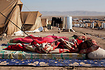 DOMIZ, IRAQ: Children sleep outside due to the heat in the Domiz refugee camp...Over 7,000 Syrian Kurds have fled the violence in Syria and are living in the Domiz refugee camp in the semi-autonomous region of Iraqi Kurdistan...Photo by Ali Arkady/Metrography