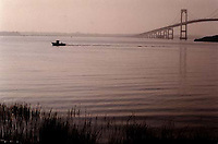 A lone fisherman travels down Narragansett Bay on this early Sunday morning