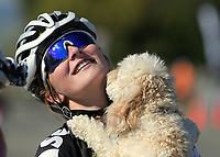 Ally Wollaston is congratulated by her dog Frankie after winning Under-19 Women's road race, Carterton-Martinborough-Gladstone circuit, on day two of the 2018 NZ Age Group Road Cycling Championships in Carterton, New Zealand on Sunday, 22 April 2018. Photo: Dave Lintott / lintottphoto.co.nz